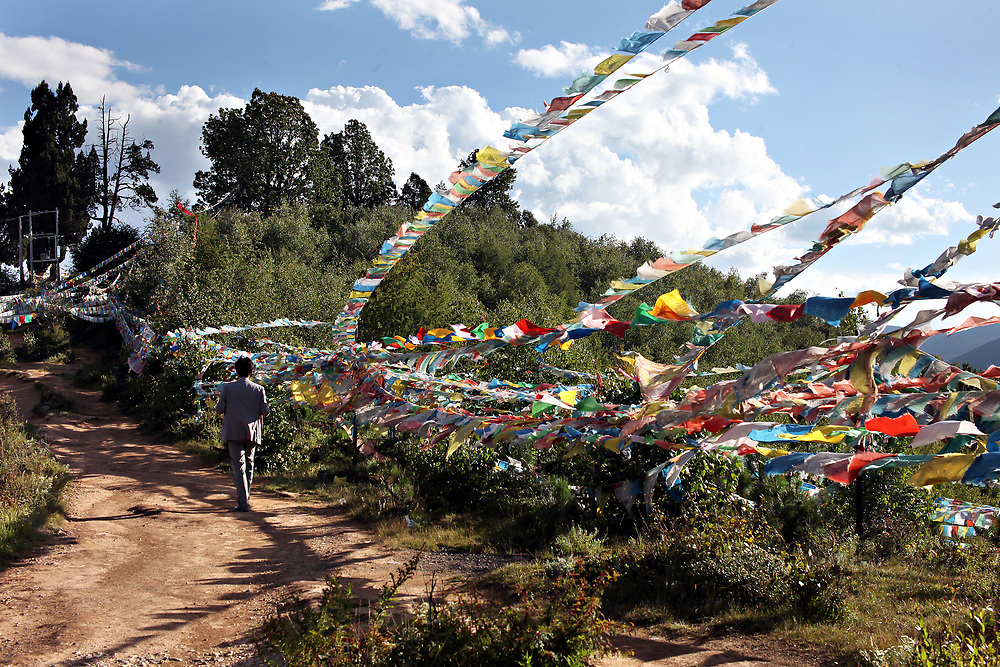 Prayer flags along the path to Chicken Temple in Shangri-la, Yunnan, China; September, 2013.