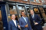 Opening vernieuwde Society Shop van de toekomst in Utrecht.<br /> <br /> Op de foto:  Ruud Gullit met Hans de Beer en Martin Groen