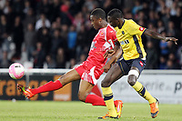 Ajaccio's forward Richard Socrier (L) vies with Sochaux's defender Yaya Banana during a French L1 football match Ajaccio vs Sochaux at the Francois Coty stadium in Ajaccio on May 2, 2012.  PHOTO PASCAL POCHARD-CASABIANCA / AFP / DPPI