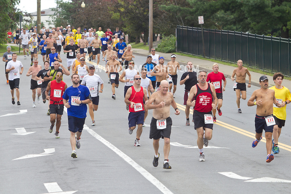 Middletown, New York - Male runners head down South Street at the start of the 2012 Run 4 Downtown road race on Saturday, Aug. 18, 2012. Men started the race 4 minutes, 21 seconds after the women.