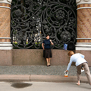 A woman sings an opera across the street from  the Church of Our Savior on Spilled Blood, a Russian-style church was built on the spot where Emperor Alexander II was assassinated in Saint Petersburg on March 1881. <br /> <br /> Photography by Jose More