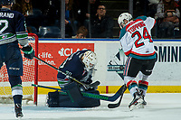 KELOWNA, CANADA - JANUARY 5: Liam Hughes #30 of the Seattle Thunderbirds makes a save as Kyle Topping #24 of the Kelowna Rockets looks for the rebound on January 5, 2017 at Prospera Place in Kelowna, British Columbia, Canada.  (Photo by Marissa Baecker/Shoot the Breeze)  *** Local Caption ***