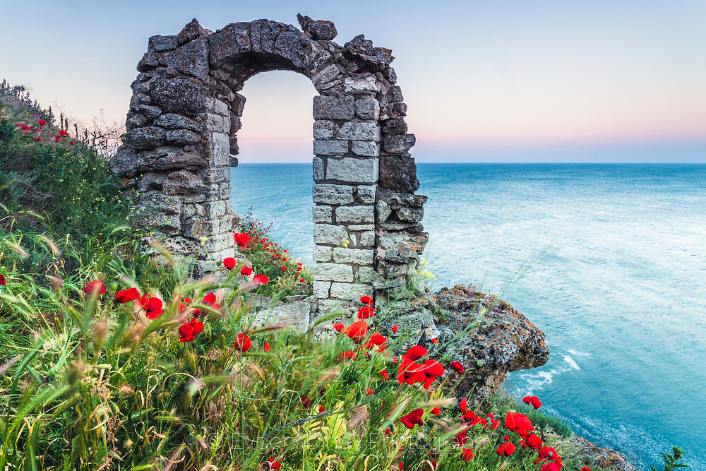 Ancient Roman gate by the sea