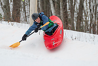 Jonah Bussgang uses his paddle skills to stay in the course at the 3rd annual Boat Bash Snow Crash with Franklin's Mill City Park at the Veteran's Memorial Ski Hill on Saturday.  (Karen Bobotas/for the Laconia Daily Sun)