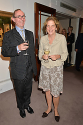 A.N.WILSON and AMICIA de MOUPRAY at a reception to celebrate the publication of Hockney - A Pilgrim's Progress by Christopher Simon Sykes held at Sotheby's, New Bond Street, London on 30th September 2014.