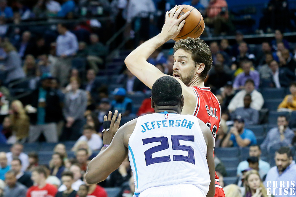 03 November 2015: Chicago Bulls forward Pau Gasol (16) looks to pass the ball over Charlotte Hornets center Al Jefferson (25) during the Charlotte Hornets  130-105 victory over the Chicago Bulls, at the Time Warner Cable Arena, in Charlotte, North Carolina, USA.