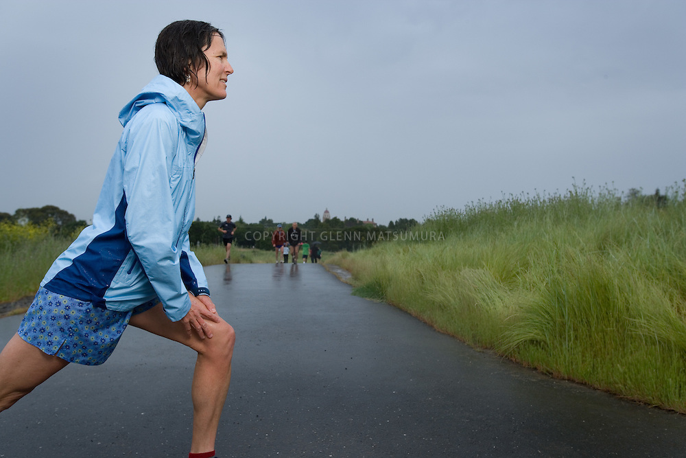 Joggers at Stanford Dish in rain