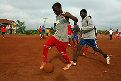 Young men and boys train football every morning on the dusty fields close to the national Stadium. Yaounde, Cameroon.
