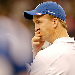 October 23, 2011; New Orleans, LA, USA; Indianapolis Colts quarterback Peyton Manning watches from the sideline during the fourth quarter of a game against the New Orleans Saints at the Mercedes-Benz Superdome. The Saints defeated the Colts 62-7. Mandatory Credit: Derick E. Hingle-US PRESSWIRE / © Derick E. Hingle 2011
