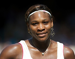 LONDON, ENGLAND - Tuesday, June 29, 2010: Serena Williams (USA) with large gold earings during the Ladies' Singles Quarter-Final match on day eight of the Wimbledon Lawn Tennis Championships at the All England Lawn Tennis and Croquet Club. (Pic by David Rawcliffe/Propaganda)