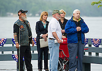 Artie Atkinson, Governor Maggie Hassan, Senator Jeanie Forrester and Bob Jones listen as Veteran Wesley Wells speaks to the crowd gathered at Hesky Park following the Freedom Ride Thursday evening.   (Karen Bobotas/for the Laconia Daily Sun)