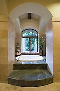 Sunken marble bath in Palm Springs home