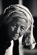 Portrait of an elderly Burmese women in a monastery in remote area of Inle Lake, Myanmar (Burma).