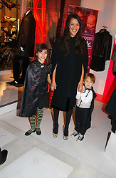 LISA MOORISH and her children MOLLY MOORISH and ASTILE DOHERTY at a party to celebrate the launch of DKNY Kids and Halloween in aid of CLIC Sargent and RX Art held at DKNY, 27 Old Bond Street, London on 31st October 2006.<br /><br />NON EXCLUSIVE - WORLD RIGHTS
