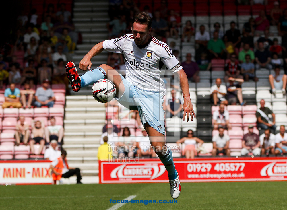 Picture by Tom Smith/Focus Images Ltd 07545141164<br /> 13/07/2013<br /> Kevin Nolan of West Ham United jumps up to control the ball during the Stephen Purches testimonial pre season friendly match at the Seward Stadium, Bournemouth.