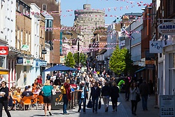 Peascod Street, the town's main shopping street is packed with tourists and royal well-wishers as excitement builds up in Windsor ahead of the royal wedding on Saturday 19th May when HRH Prince Harry weds actress Megan Markle. Windsor, May 17 2018.