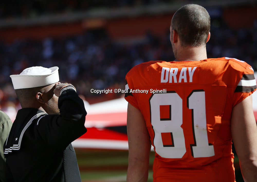 Cleveland Browns tight end Jim Dray (81) stands next to a member of the United States Navy who salutes during the playing of the National Anthem before the Cleveland Browns 2015 week 8 regular season NFL football game against the Arizona Cardinals on Sunday, Nov. 1, 2015 in Cleveland. The Cardinals won the game 34-20. (©Paul Anthony Spinelli)