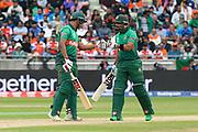 Mohammad Saifuddin of Bangladesh and Sabbir Rahman of Bangladesh touch gloves during the ICC Cricket World Cup 2019 match between Bangladesh and India at Edgbaston, Birmingham, United Kingdom on 2 July 2019.