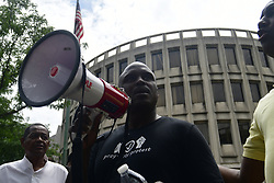 Organizer and columnist Salamon Jones speaks as community members and activist and elected officials convene to demand removal of 330 officers from street duty at a protest at Police Headquarters, in Philadelphia, PA on June 7, 2019. Philadelphia Police Department Commissioner Richard Ross announced an outside law firm to review the Plain View Project's database with racist or offensive social media posts by (past and current) officers.