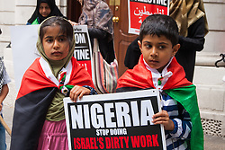 London, July 28th 2014.  Palestinian supporters in London protest at the Nigerian embassy against the alleged killing of 33 pro-Palestinian supporters including children, by Nigerian troops in Zaria, who ambushed the tail end of an Al-Quds Day march.