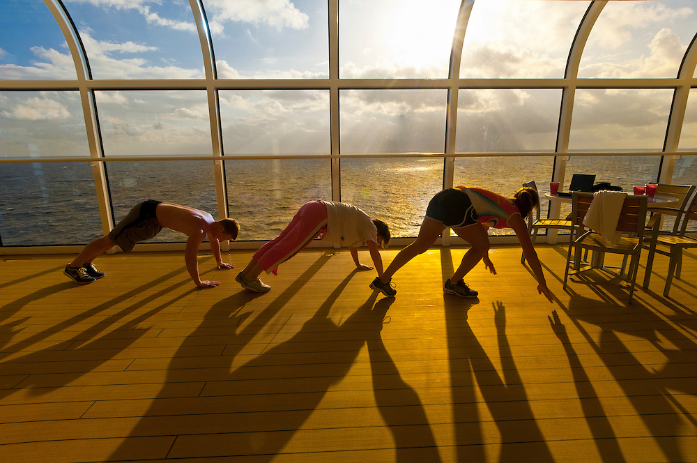 Passengers exercising aboard the new Disney Dream cruise ship sailing between Florida and the Bahamas.