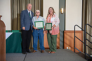 President Nellis stands with Jane Vaughn (Center) and Bonnie Belm- Geddes who are retiring with 30 years of service at the Annual Classified Staff  Service Award Ceremony.  Photo by Ben Siegel