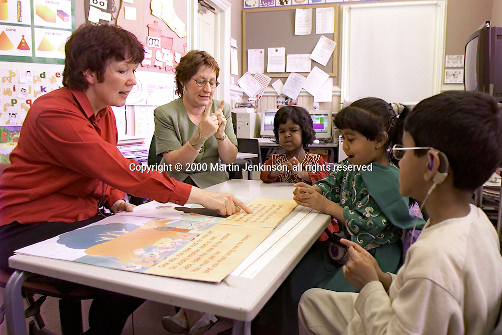 "Signer assists Teacher during ""Literacy Hour"" teaching of hearing impaired pupils....© Martin Jenkinson tel 0114 258 6808  mobile 07831 189363 email admin@pressphotos.co.uk  NUJ recommended terms & conditions apply. Copyright Designs & Patents Act 1988. Moral rights asserted credit required. No part of this photo to be stored, reproduced, manipulated or transmitted by any means without prior written permission."