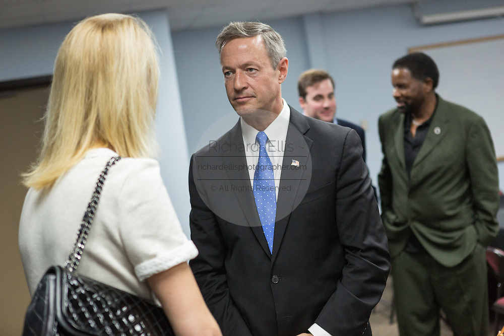 Former Maryland Governor and Democratic presidential candidate Martin O'Malley talks with a supporter following a discussion on gun violence at Mt. Moriah Baptist Church October 22, 2015 in North Charleston, South Carolina.
