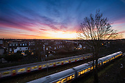 UNITED KINGDOM, London: 13 Jan 2016 The sun starts to rise on yet another beautiful January morning over passing London Underground carriages in Southfields, South West London. Rick Findler / Story Picture Agency