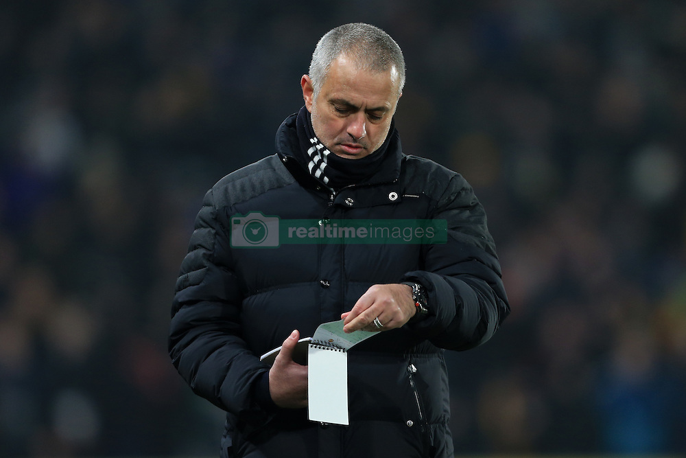 26th January 2017 - EFL Cup (Semi-Final) - Hull City v Manchester United - Man Utd manager Jose Mourinho checks his notepad - Photo: Simon Stacpoole / Offside.