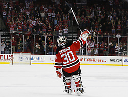 Feb 26, 2009; Newark, NJ, USA; New Jersey Devils goalie Martin Brodeur (30) salutes the crowd after being named the first star for recording a shutout in his return at the Prudential Center. The Devils defeated the Avalanche 4-0.