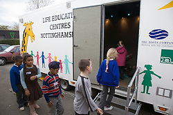 Primary school children filing into a mobile classroom for a life skills lesson,
