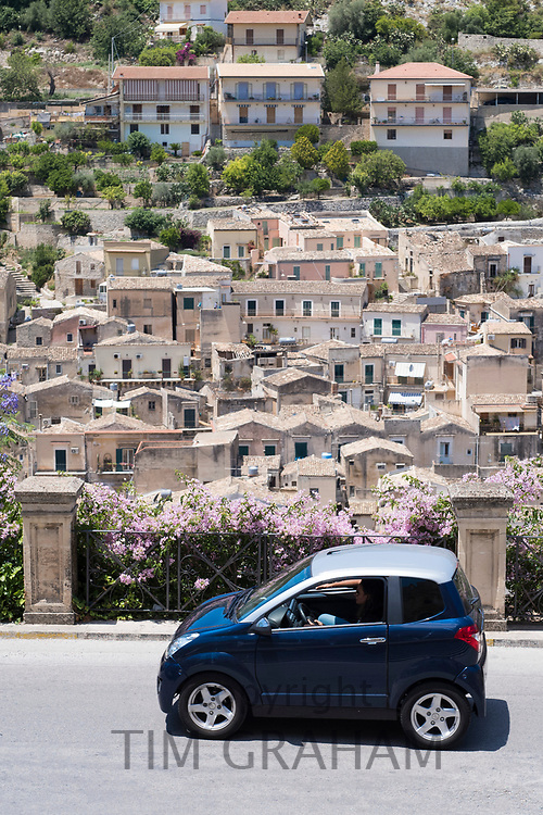 Compact blue small city car in the hill city of Modica Alta famous for its Baroque architecture, South East Sicily