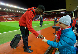 LIVERPOOL, ENGLAND - Wednesday, March 2, 2016: Liverpool's Kolo Toure signs an autograph as he arrives before the Premier League match against Manchester City at Anfield. (Pic by David Rawcliffe/Propaganda)