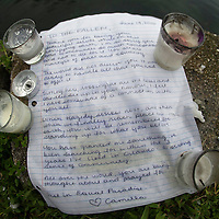 A handwritten note is seen after a thunderstorm at a makeshift memorial at Lake Eola Park for the victims of the Pulse nightclub where many victims were killed in the deadliest shooting in modern U.S. History on Tuesday, June 14, 2016, in Orlando, Fla. (Alex Menendez via AP)