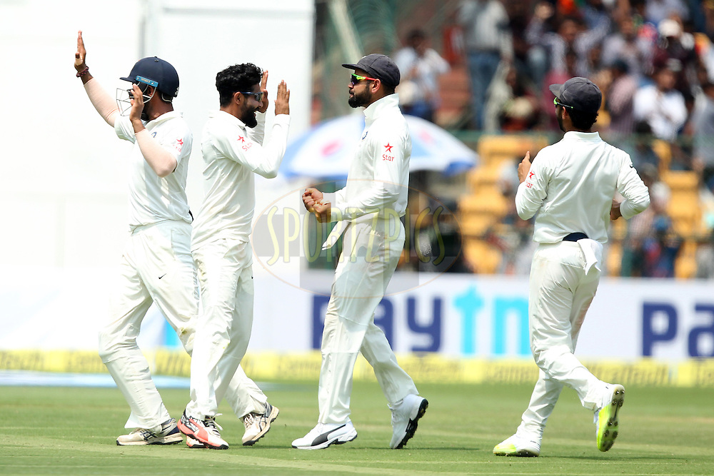 Ravindra Jadeja and Virat Kohli captain of India celebrates wicket of Matthew Renshaw of Australia during day two of the second test match between India and Australia held at the M Chinnaswamy Stadium in Bangalore on the 5th March 2017. Photo by: Prashant Bhoot / BCCI/ SPORTZPICS