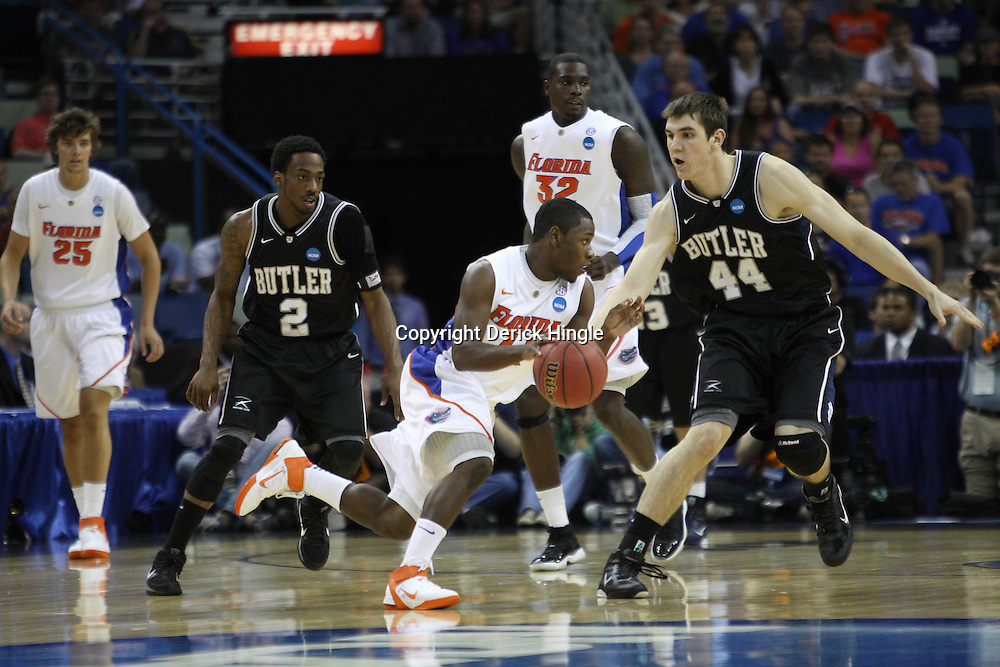 Mar 26, 2011; New Orleans, LA; Florida Gators guard Erving Walker (11) drives past Butler Bulldogs center Andrew Smith (44) during the first half of the semifinals of the southeast regional of the 2011 NCAA men's basketball tournament at New Orleans Arena.   Mandatory Credit: Derick E. Hingle