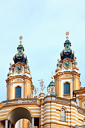 """The ornate twin towers of Melk Abbey are landmarks on a Danube transit.<br /> <br /> From Wikipedia: """"Melk Abbey or Stift Melk is an Austrian Benedictine abbey, and one of the world's most famous monastic sites. It is located above the town of Melk on a rocky outcrop overlooking the river Danube in Lower Austria, adjoining the Wachau valley.<br /> <br /> The abbey was founded in 1089 when Leopold II, Margrave of Austria gave one of his castles to Benedictine monks from Lambach Abbey. A school was founded in the 12th century, and the monastic library soon became renowned for its extensive manuscript collection. The monastery's scriptorium was also a major site for the production of manuscripts. In the 15th century the abbey became the centre of the Melk Reform movement which reinvigorated the monastic life of Austria and Southern Germany.<br /> <br /> Today's impressive Baroque abbey was built between 1702 and 1736 to designs by Jakob Prandtauer. Particularly noteworthy is the abbey church with frescos by Johann Michael Rottmayr and the impressive library with countless medieval manuscripts, including a famed collection of musical manuscripts and frescos by Paul Troger."""""""