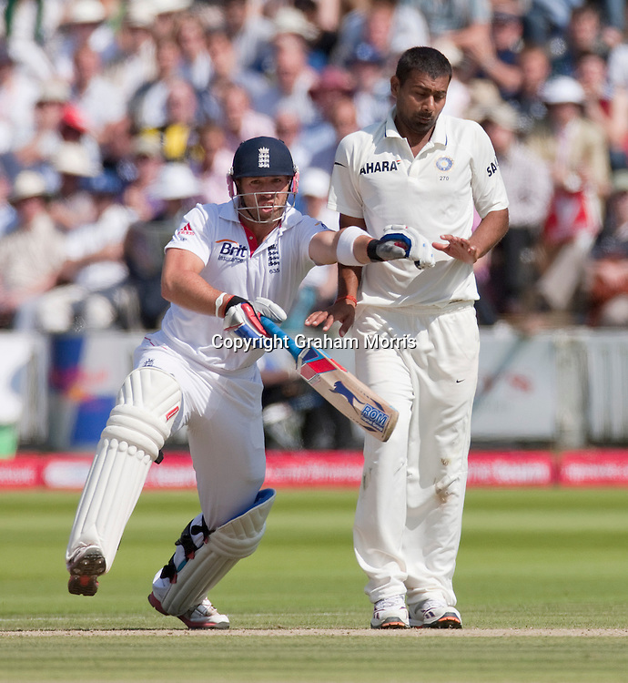 Matt Prior collides with bowler Praveen Kumar during the first npower Test Match between England and India at Lord's Cricket Ground, London.  Photo: Graham Morris (Tel: +44(0)20 8969 4192 Email: sales@cricketpix.com) 24/07/11