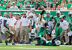 Sep 6, 2015; Huntington, WV, USA; Purdue Boilermakers wide receiver Danny Anthrop goes airborne after being hit by a Marshall Thundering Herd defender during the first quarter at Joan C. Edwards Stadium. Mandatory Credit: Ben Queen-USA TODAY Sports