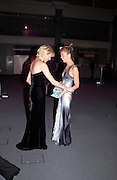 Lady Rothschild and Heather Kerzner, Fundraising party with airline theme in aid of the Old Vic and to celebrate the appointment of Kevin Spacey as artistic director.  <br />Old Billinsgate Market.  5 February 2003. © Copyright Photograph by Dafydd Jones 66 Stockwell Park Rd. London SW9 0DA Tel 020 7733 0108 www.dafjones.com