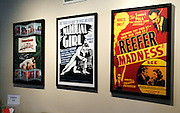 Vintage posters hang on the wall in the waiting area in a medical marijuana center in Denver April 2, 2012.  With Colorado voters set in November to decide whether to defy the federal government and legalize marijuana for recreational use under state law, the enforcement division could play a key role in bringing a black market pot trade out of the shadows.  REUTERS/Rick Wilking (UNITED STATES)