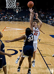Virginia Cavaliers F Kelly Hartig (42) shoots over George Washington Colonials F Jamila Bates (33).  The Virginia Cavaliers women's basketball team fell to the #14 ranked George Washington Colonials 70-68 at the John Paul Jones Arena in Charlottesville, VA on November 12, 2007.