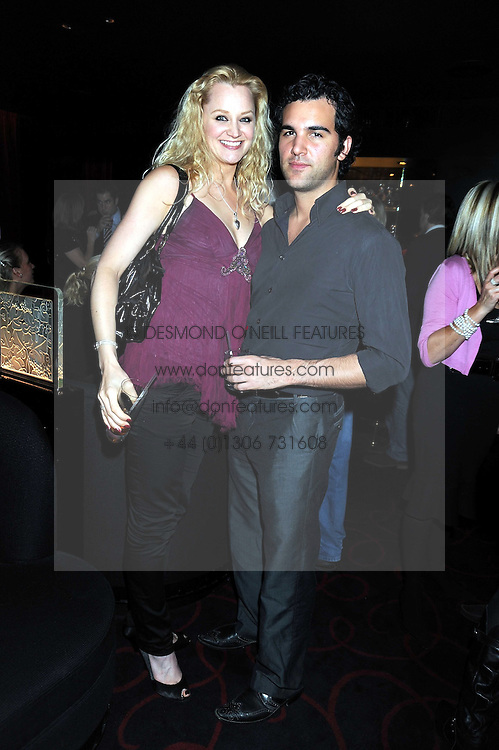 EMMA-JANE APPLEYARD and actor JUAN PABLO DIPACE at a private party following the first night of 'Fat Pig' held at L'Atelier, 13-15 West Street, London WC2 on 20th October 2008.