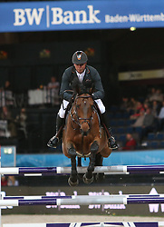 20.11.2015, Schleyer Halle, Stuttgart, GER, FEI World Cup, Stuttgart German Masters, Preis der Raumpflege AG, Internationale Springpruefung, im Bild Jeroen Dubbeldam (Niederlande) auf SFN Zenith N.O.P. // during price of Raumpflege AG, International Jumping Competition of FEI World Cup Stuttgart German Masters at the Schleyer Halle in Stuttgart, Germany on 2015/11/20. EXPA Pictures &copy; 2015, PhotoCredit: EXPA/ Eibner-Pressefoto/ Fudisch<br /> <br /> *****ATTENTION - OUT of GER*****