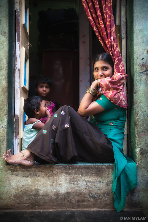 Woman in a Window - Dharavi, Mumbai, India