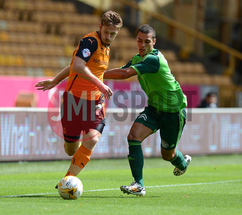 Wolverhampton's James Henry battles for the ball withCelta Vigo's Samu   - Photo mandatory by-line: Alex James/JMP - Tel: Mobile: 07966 386802 2/08/2014 - SPORT - FOOTBALL - Wolverhampton - Molineux Stadium -   Wolverhampton vs  Celta Vigo - preseason