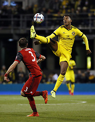 November 21, 2017 - Columbus, OH, USA - Columbus Crew forward Ola Kamara (11) leaps for a ball over Toronto FC defender Drew Moor (3) during the first half of the first leg of the MLS Eastern Conference finals at MAPFRE Stadium in Columbus, Ohio, on Tuesday, Nov. 21, 2017. (Credit Image: © Adam Cairns/TNS via ZUMA Wire)