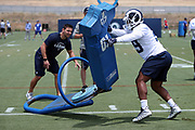 Los Angeles Rams rookie linebacker Micah Kiser (59), a 5th round pick in the 2018 NFL draft, works out on a blocking sled as Los Angeles Rams assistant linebackers coach David Shula looks on during the Los Angeles Rams NFL football camp on Monday, June 4, 2018 in Thousand Oaks, Calif. (©Paul Anthony Spinelli)