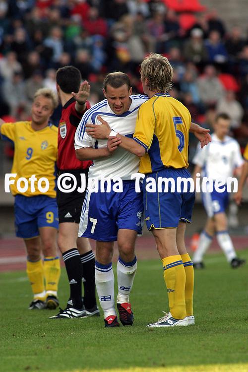 28.05.2004, Ratina Stadium, Tampere, Finland..Friendly International match, Finland v Sweden.Mika Nurmela (Finland) & Erik Edman (Sweden).©Juha Tamminen